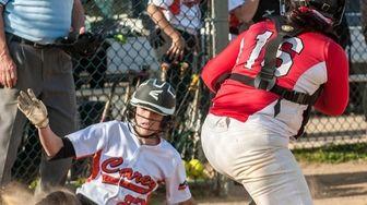 Carey's Amanda Ulzheimer, left, slides around Plainedge's catcher