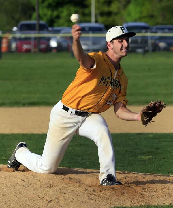 Ward Melville relief pitcher Joe Flynn delivers in