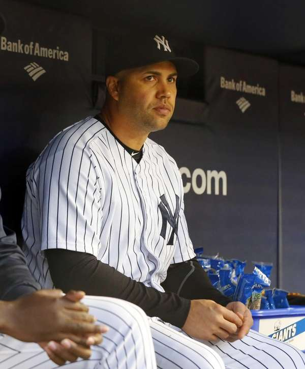The Yankees' Carlos Beltran looks on from the