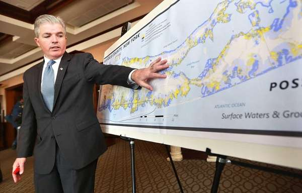 Suffolk County Executive Steve Bellone uses a map