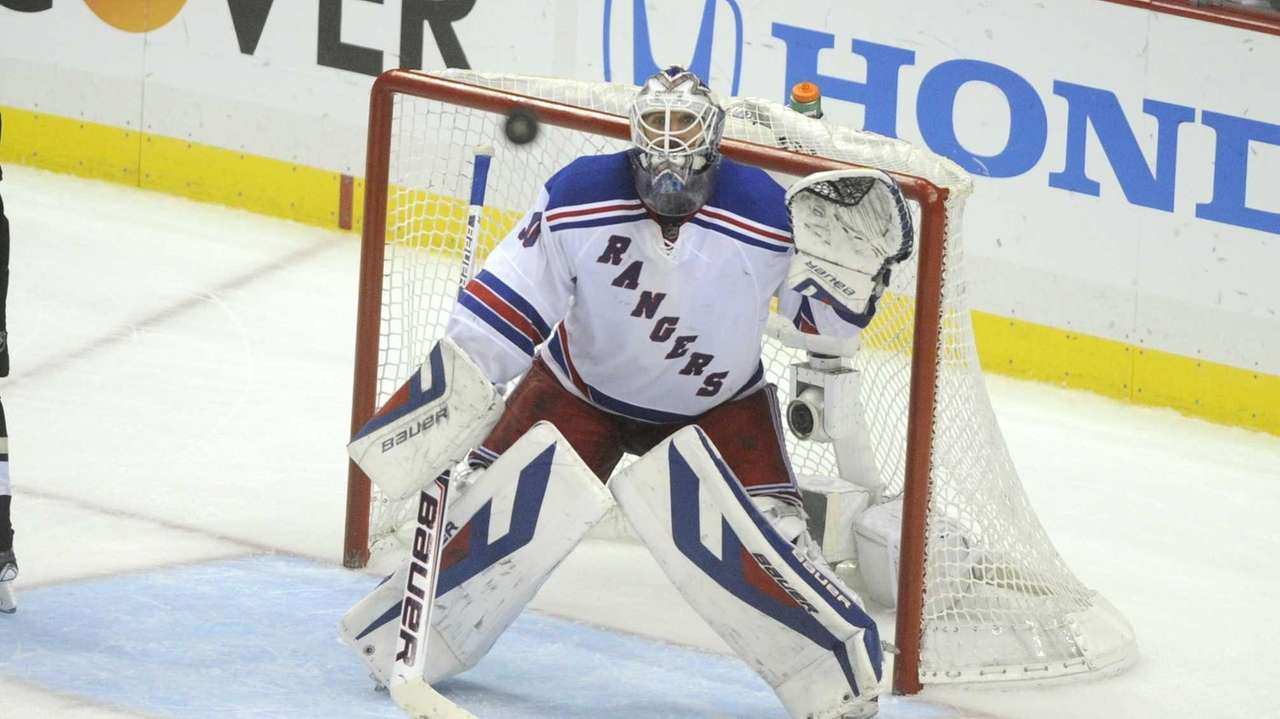 Rangers goalie Henrik Lundqvist watches the puck during