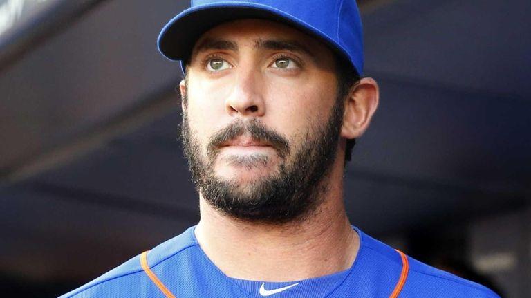 Matt Harvey of the Mets looks on before