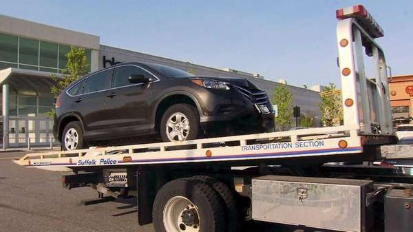 Suffolk County police remove a 2014 Honda CR-V