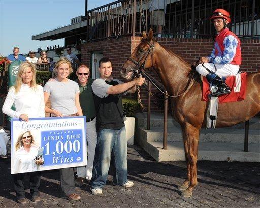 Linda Rice, left, celebrates her 1000th win next