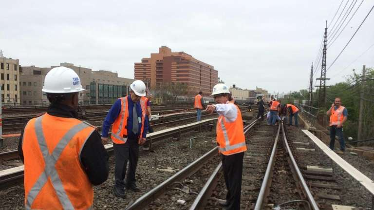 MTA officials Inspect track damaged after a freight