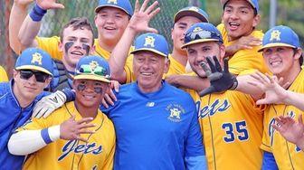 East Meadow baseball head coach Ken Sicoli celebrates