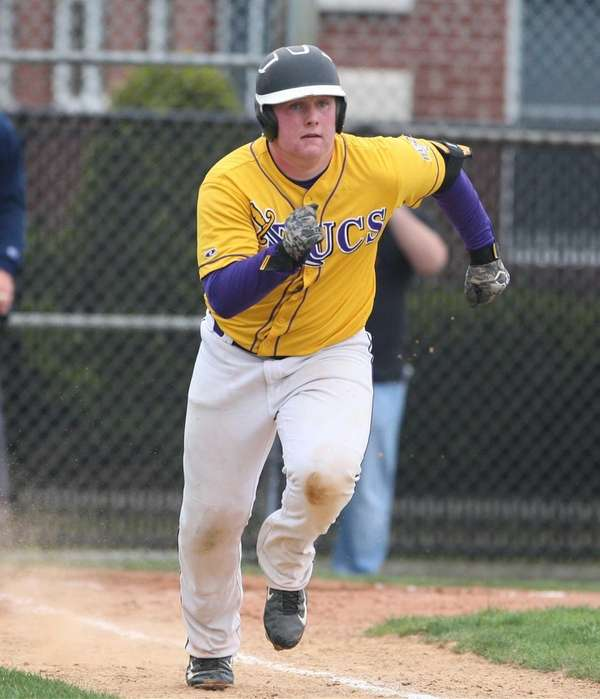 Kevin Colgan of Islip gets safety to first