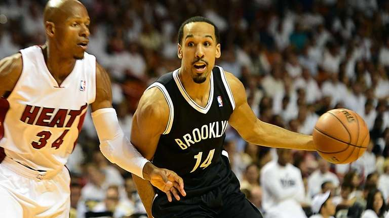 The Nets' Shaun Livingston looks to drive past