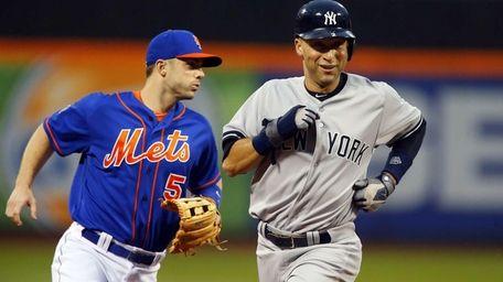 Derek Jeter of the Yankees runs past David