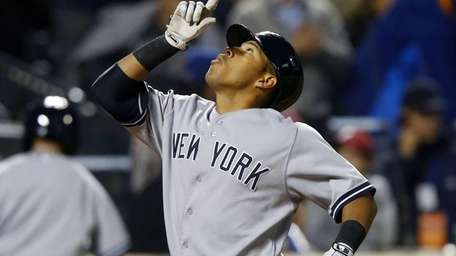 Yangervis Solarte of the Yankees celebrates his fourth-inning
