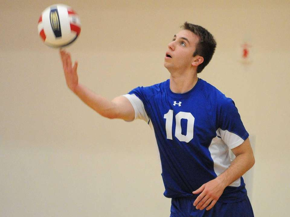 Kellenberg's Michael Fulop makes a serve during the