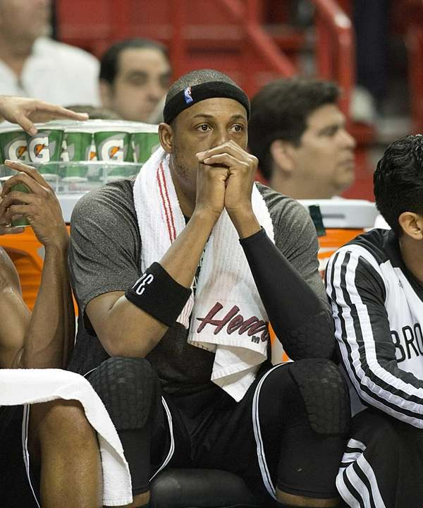 The Nets' Paul Pierce looks on from the