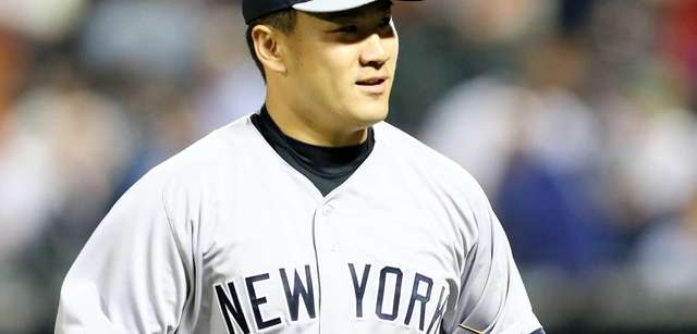 Masahiro Tanaka celebrates as he walks off the