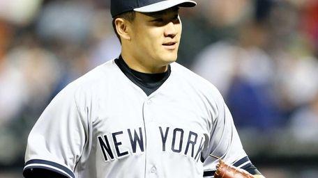 Masahiro Tanaka celebrates as he walks off the