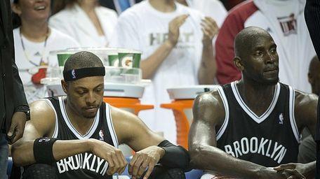 Nets' Paul Pierce and Kevin Garnett look on