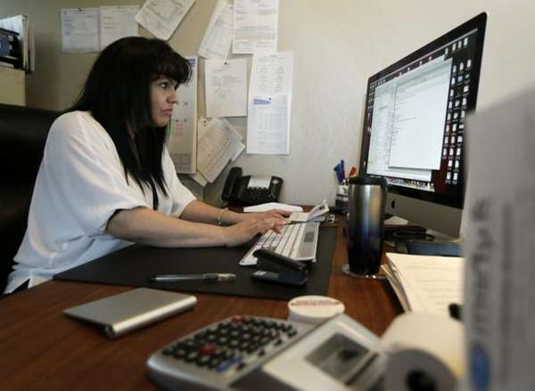 Consuelo Gomez works in her office at facilities
