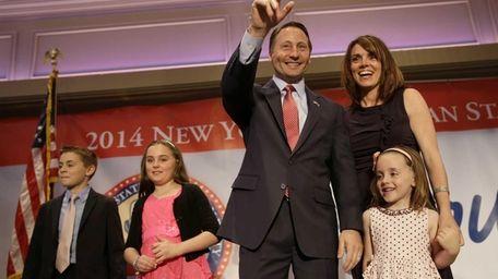Republican gubernatorial nominee Rob Astorino stands on stage