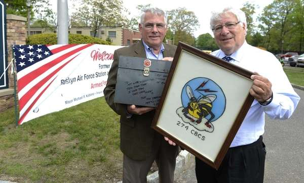 Village of East Hills Mayor Michael Koblenz, right,