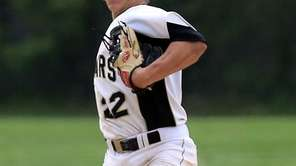 Commack shortstop Jesse Berardi throws to first in