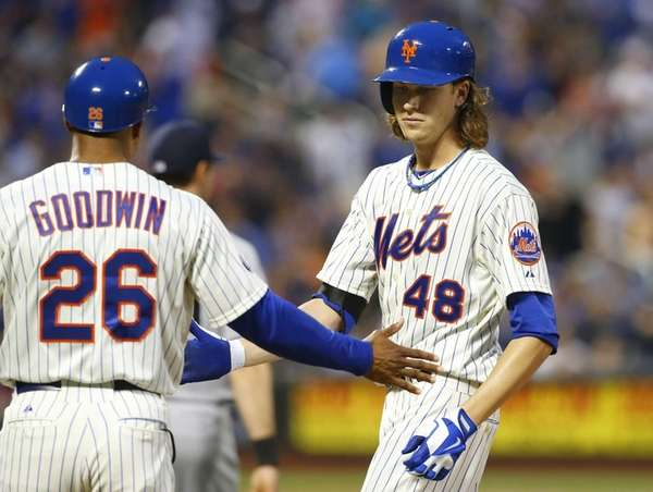 Jacob deGrom of the Mets is congratulated on