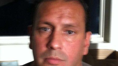 James Muniz, 44, of Roslyn, the fugitive head
