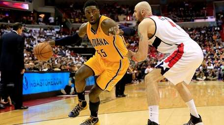 Roy Hibbert of the Indiana Pacers drives with