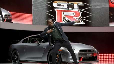 Olympic gold medalist Usain Bolt poses in front
