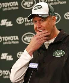 Jets head coach Rex Ryan talks with the