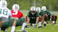 Safety Calvin Pryor of the Jets stretches during
