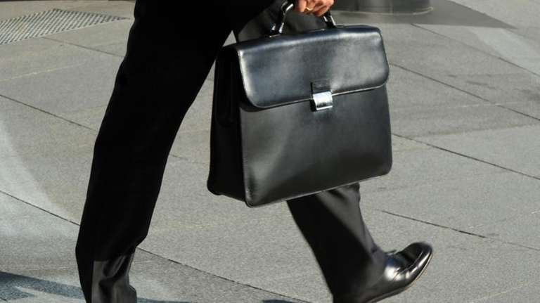 Man walking with a briefcase.