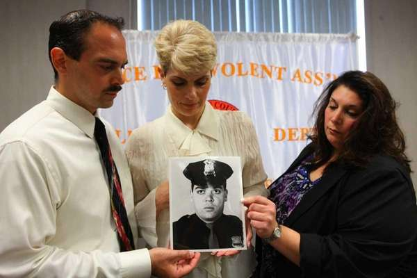 Matthew Giglio, Regina Giglio and Doreen Giglio-Velardi, family of slain Nassau County Police Officer Matthew Giglio, with Nassau County PBA president James Carver at the PBA headquarters to urge officials to keep convicted cop killer John MacKenzie in prison on May 30, 2012 in Mineola.