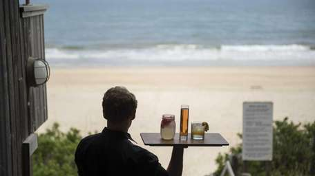 A waiter at Gurney's Resort and Spa walks