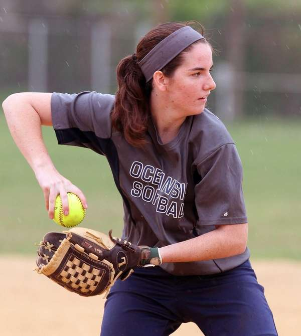 Oceanside softball player Claire McNamara throws the ball
