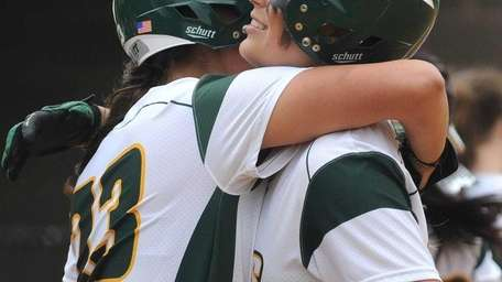 LIU Post shortstop Nicole Hagenah, left, gets a