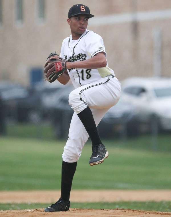 Sachem North's Nick Morena throws a pitch in