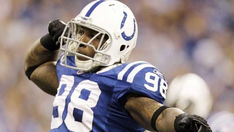 Colts defensive end Robert Mathis reacts following a