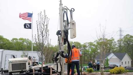 Land Water Environmental Services work on removing dirt