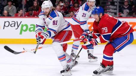 Rick Nash of the Rangers and Andrei Markov