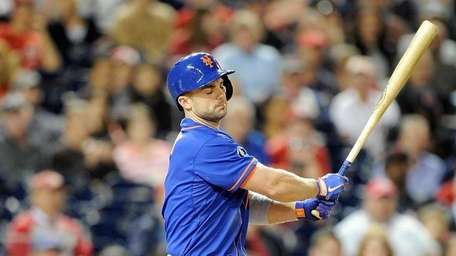David Wright of the Mets reacts after striking