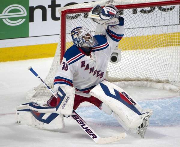 Rangers goalie Henrik Lundqvist makes a glove saveHenrik Lundqvist Glove Save