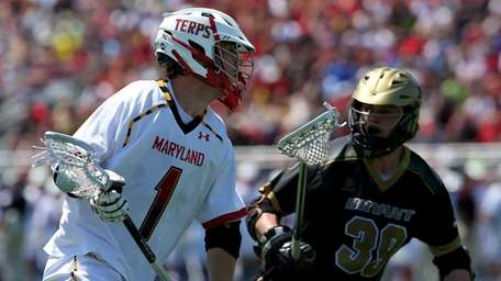 Maryland's Mike Chanenchuk looks for the open shot
