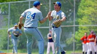 East Meadow pitcher Brian Kavanagh celebrates with third