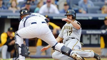Gaby Sanchez of the Pittsburgh Pirates is tagged