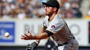 Ike Davis of the Pittsburgh Pirates flips the