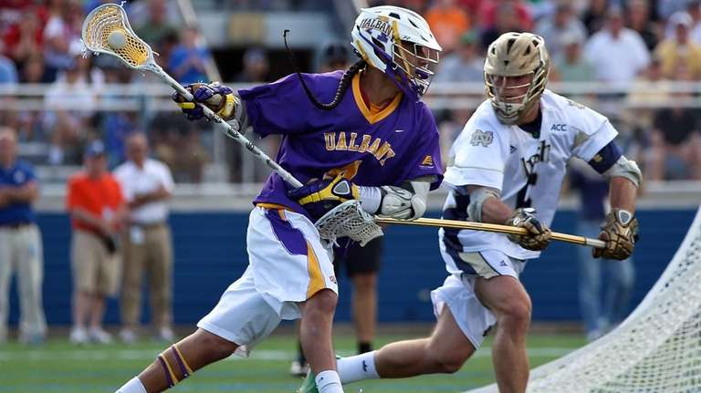 Albany's Lyle Thompson moves around the net against