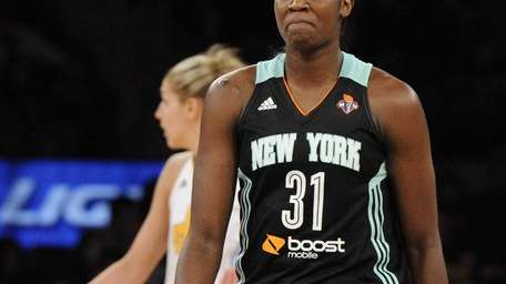 Liberty center Tina Charles looks on from the