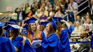 Students celebrate their graduation at the 2014 commencement