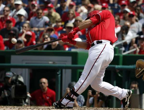 Washington Nationals catcher Wilson Ramos hits a two-RBI