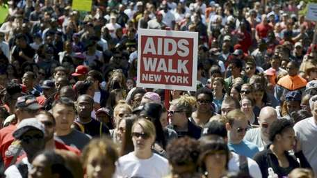 Participants march in the 29th Annual AIDS Walk