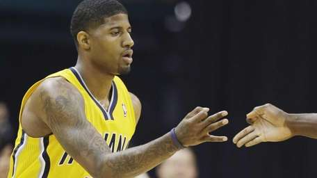 Indiana Pacers forward Paul George (24) gestures with